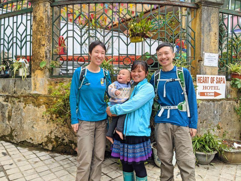 Jackie Szeto and Justin Huynh, Life Of Doing, stand around Zaazaa, owner of Zaazaa Trekking, in Sapa, Vietnam