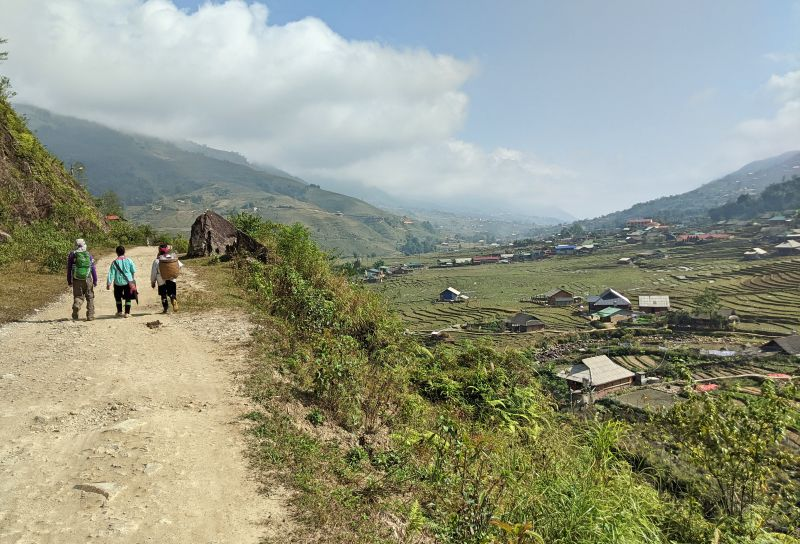 Justin Huynh, Life Of Doing, walks next to Sapa trekking guide and a local woman in Sapa, Vietnam