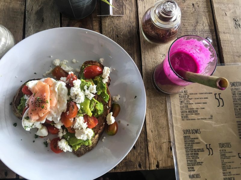 Avocado toast with cheese and smoked salmon and fresh juice