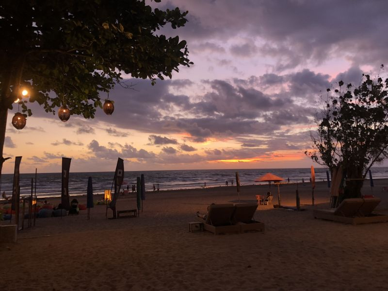 Sunset with purple skies from the beach at Moonlite Kitchen and Bar in Bali