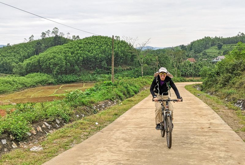 Justin Huynh, Life Of Doing, cycles up the paved path to Bong Lai Valley in Phong Nha, Vietnam