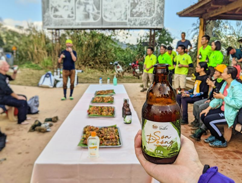 A hand holding a bottle of Song Doong craft beer