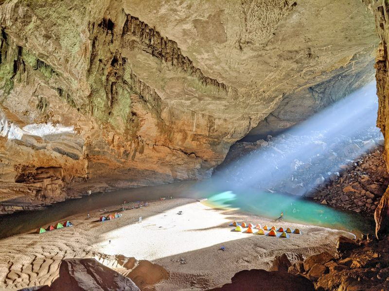 A beam of light shines into the Hang En Cave in Phong Nha, Vietnam