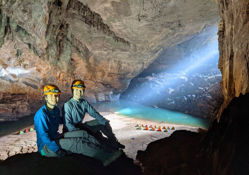Jackie Szeto and Justin Huynh, Life Of Doing, is at the top of the cave with the Hang En sunbeam in the background