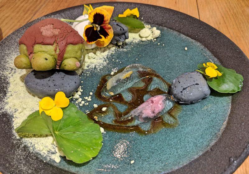 A turtle shaped bread and koi fish dessert at Miyama Cafe