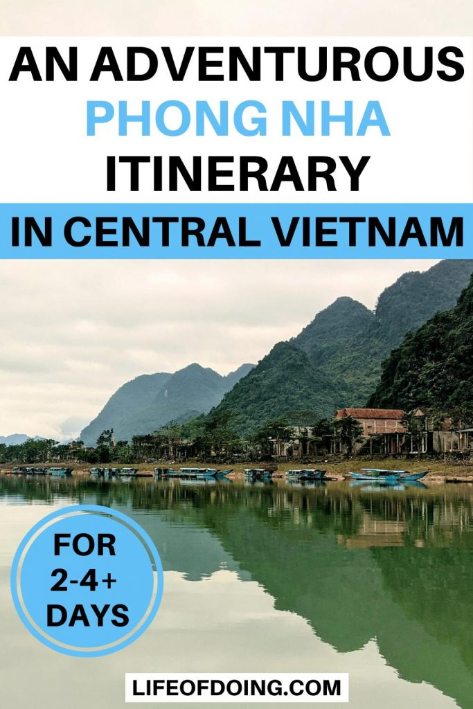 One of the best things to do on your Phong Nha itinerary is to see the views of the Con River with the blue boats and limestone caves and mountains.