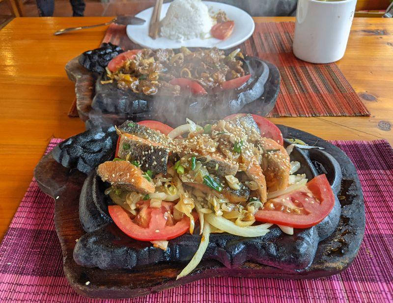 Sizzling platter of salmon and lamb at Good Morning Restaurant in Sapa, Vietnam