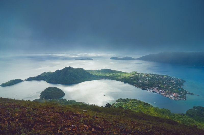 Aerial view of a small island when hiking around Banda Islands in Indonesia
