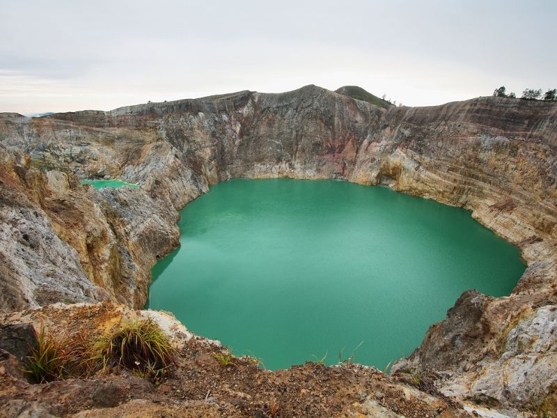 Turquoise green lakes in a Kelimutu crater