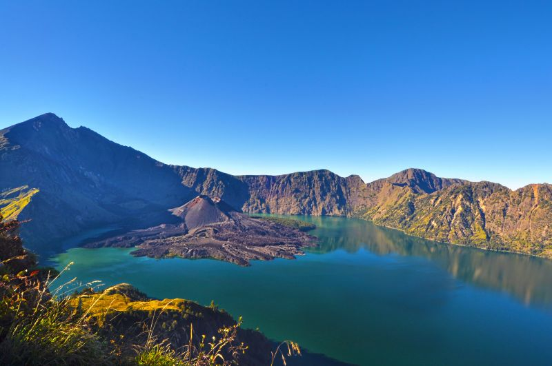 View of a blue lake in a volcanic crater of Rinjani in Lombok, Indonesia