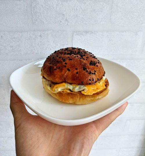 Egg burger with black sesame bun from Merlion Cafe