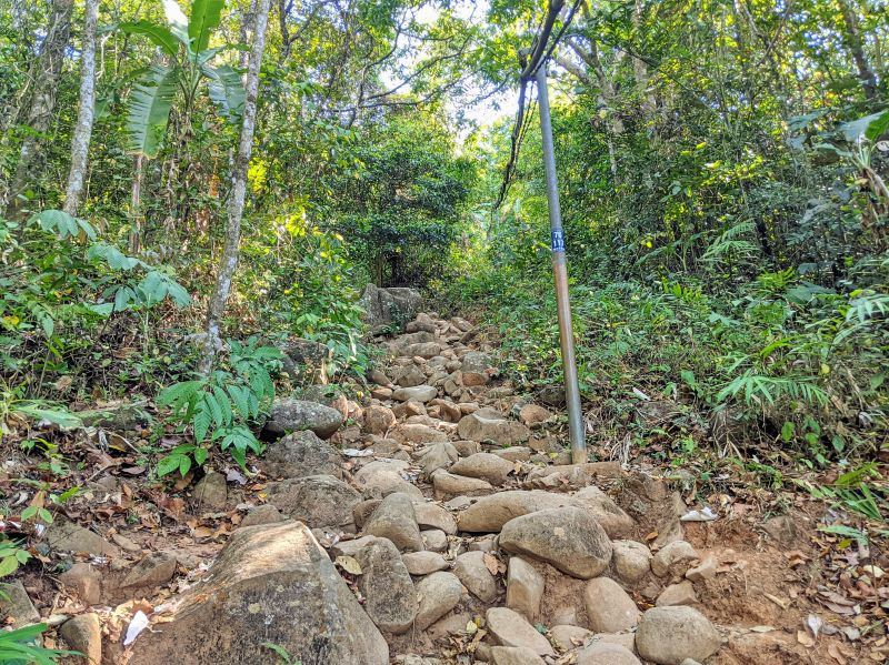 The Ba Den Mountain hiking trail has mostly rocks as the hiking path