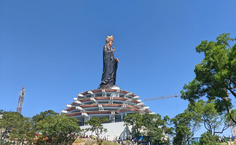 Seeing the bronze Lady Buddha statue is a highlight when hiking up Ba Den Mountain in Tay Ninh, Vietnam