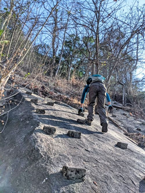 Jackie Szeto, Life Of Doing, climb up the face of the rocks with stepping stones on Ba Den Mountain, Vietnam