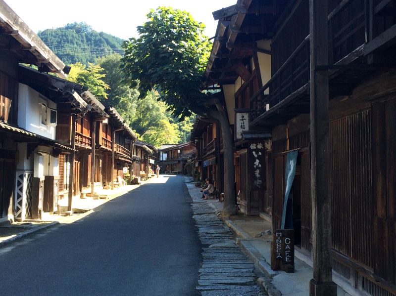 Walk through towns to see traditional Japanese housing when hiking Magome to Tsumago Trail.