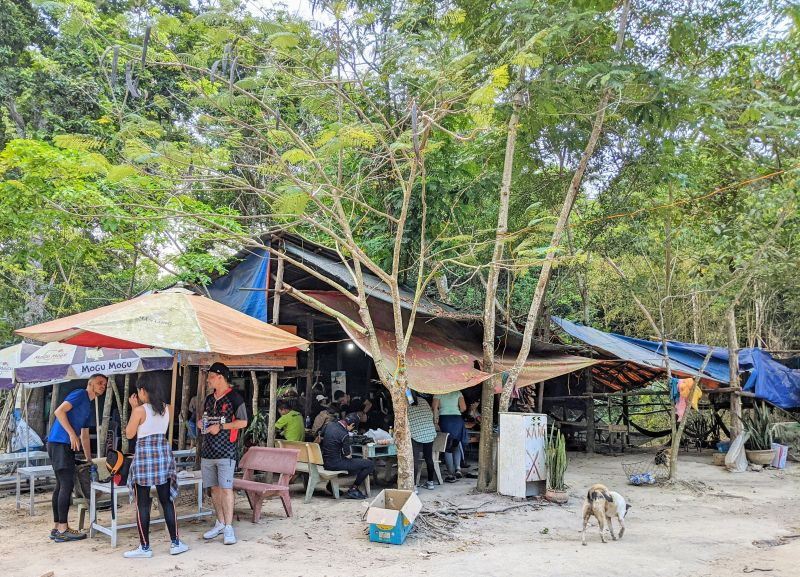 Parking lot area with a local kiosk selling drinks and food on Nui Dinh Mountain