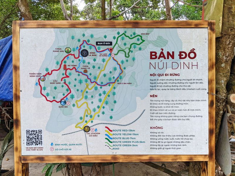 A map of the Nui Dinh Mountain hiking trail with red, yellow, blue, and green lines representing the different routes