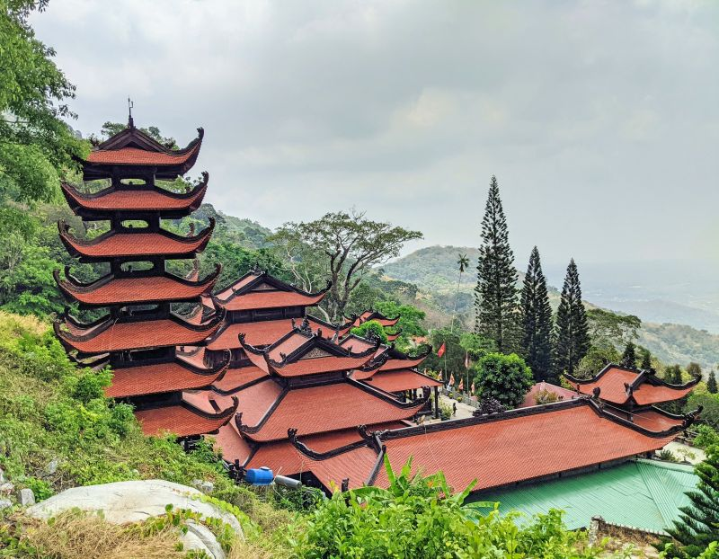 Red and black rooftops of the Linh Son Truong Tho Pagoda that overlooks the hillside on Ta Cu Mountain