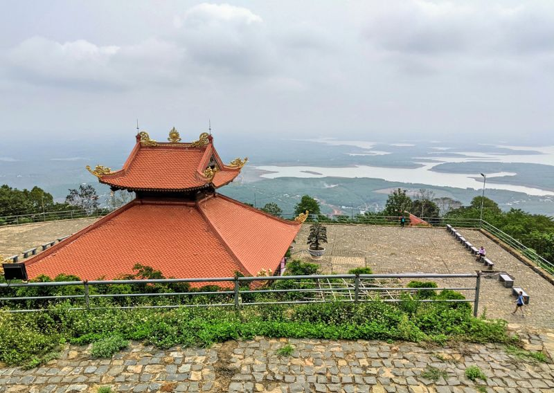 Orange rooftop of a temple that overlooks the lakes and forest area of Binh Phuoc's Ba Ra Mountain