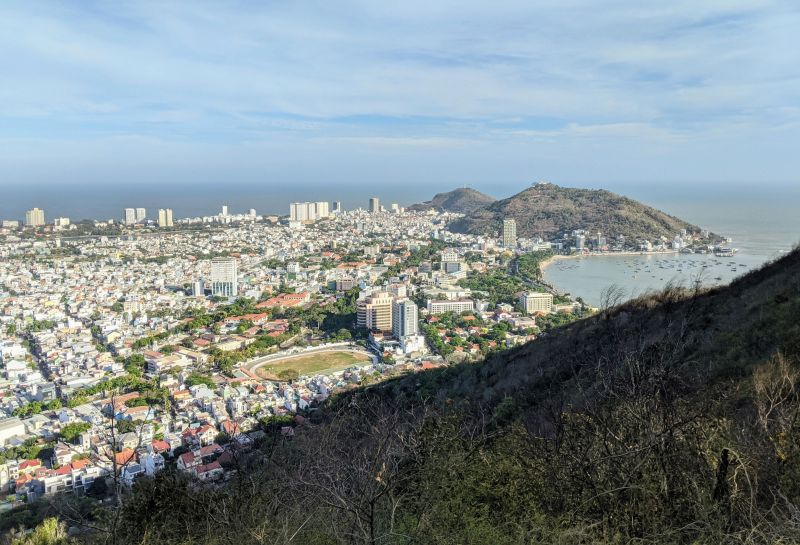 Panoramic view of Vung Tau neighborhoods and the bay from a summit point on hiking Nui Lon Big Mountain in Vung Tau, Vietnam