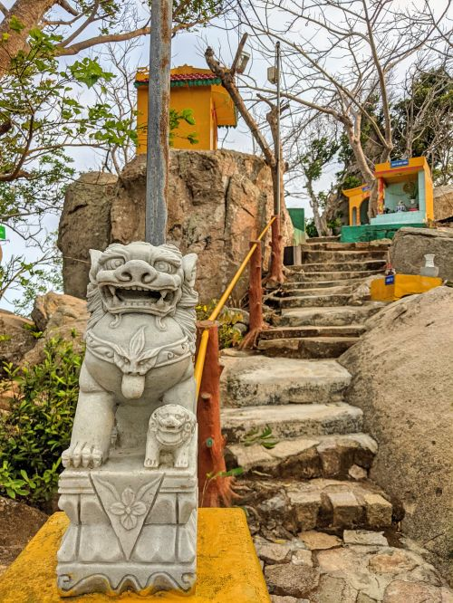 Gray marble lion statue at the entrance of the Bong Lai temple on Minh Dam Mountain near Vung Tau, Vietnam