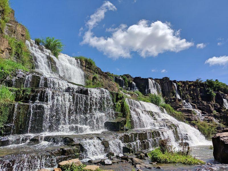 Multi-layered water cascades of Pongour Waterfall in Dalat, Vietnam
