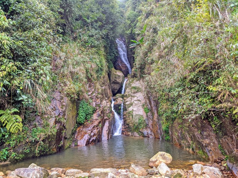 A small waterfall stream at an unknown waterfall in Muong Hoa Valley, Sapa, Vietnam