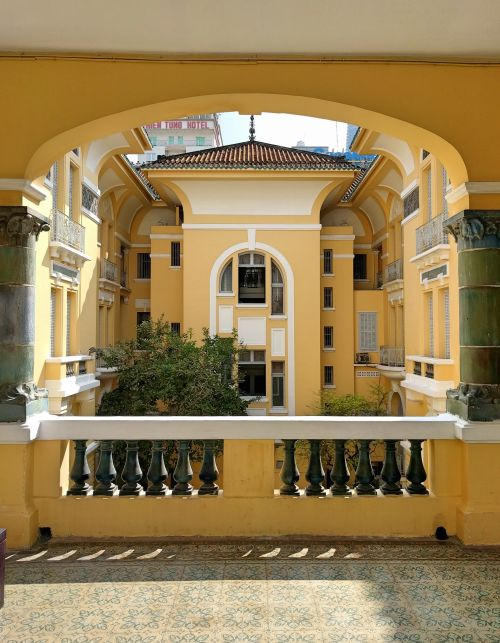 A yellow and white building that overlooks the courtyard at the Fine Arts Museum in Ho Chi Minh City, Vietnam