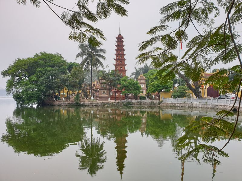 The red Tran Quoc Pagoda surrounded by a lake in Hanoi, Vietnam