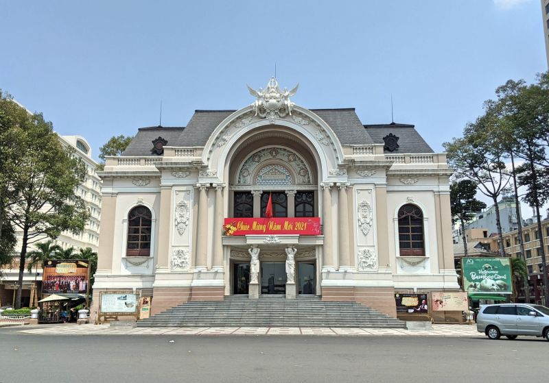 A beige and white building with white statues at the Saigon Opera House in Ho Chi Minh City, Vietnam