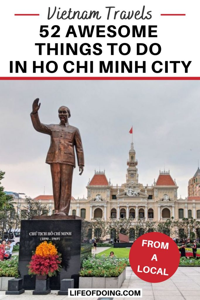 Visit Ho Chi Minh Statue with the Vietnam flag in the background as one of the top things to do in Ho Chi Minh City, Vietnam