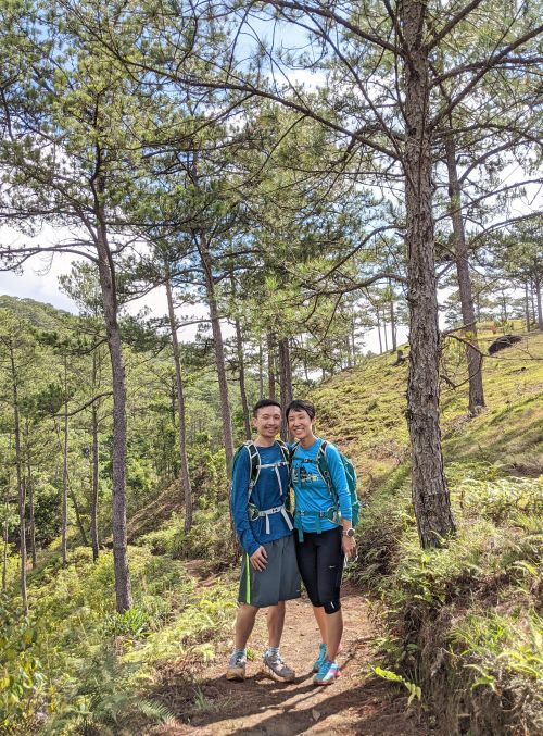 Justin Huynh and Jackie Szeto, Life Of Doing, stand in the main forest area to go to the Tam Tham Waterfall.