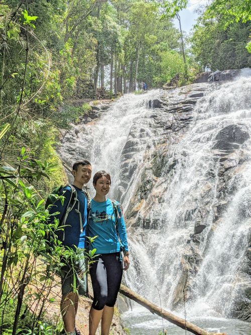 Justin Huynh and Jackie Szeto, Life Of Doing, stand in front of the Tam Tham Waterfall in Dalat, Vietnam