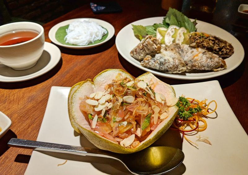 Pomelo salad with almonds and a plate of deep-fried square mushroom rolls from Hum Vegetarian in Ho Chi Minh City, Vietnam