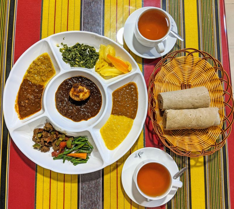 Ethopian food with lentils, vegetables, meat with egg, and injera bread from Sara Ethiopian, Ho Chi Minh City, Vietnam