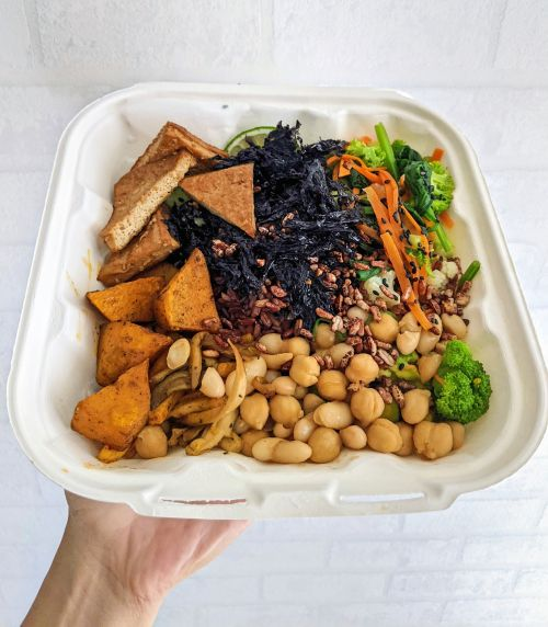 This Buddha Bowl has red rice, tofu, potatoes, chickpeas, broccoli, chickpeas, and shredded seaweed from Zeroism in Ho Chi Minh City