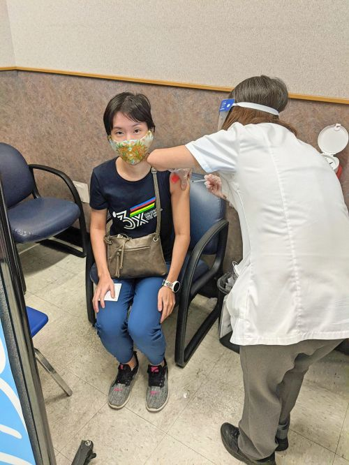 Jackie Szeto, Life Of Doing, takes her first COVID-19 vaccine at Walgreens.