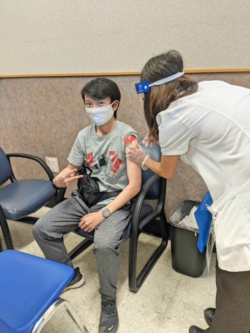 Justin Huynh, Life Of Doing, receives his second COVID-19 vaccine at Walgreens.