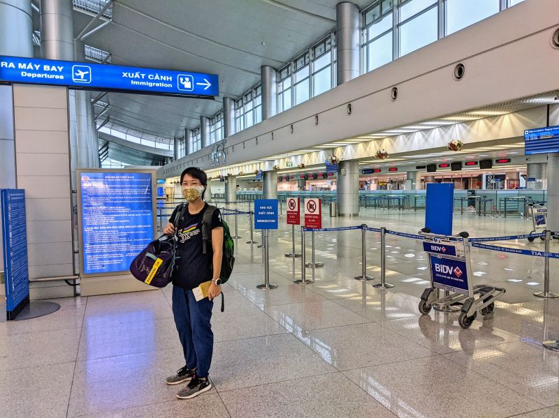 Jackie Szeto, Life Of Doing, waits in front of the empty Immigration section at Tan Son Nhat International Airport in Ho Chi Minh City, Vietnam