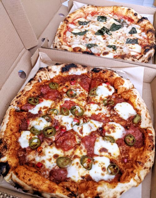Two pizzas delivered from Brick & Barrel - first one is a spicy pizza with pepperoni and the second one is a Margherita with mushroom