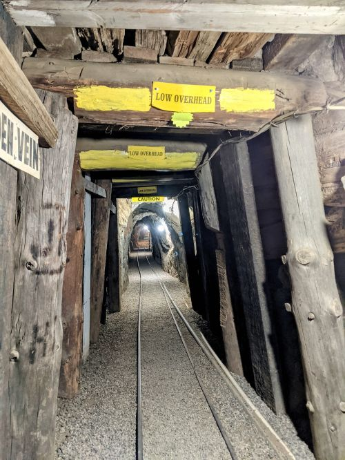 Inside the underground Eagle Mining cave which has a line for the carts to pass through the mine.