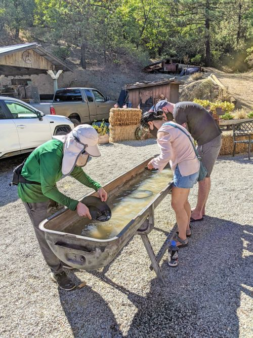 Justin Huynh, Life Of Doing, and a man and woman pan for gold at Eagle Mining Company in Julian, California