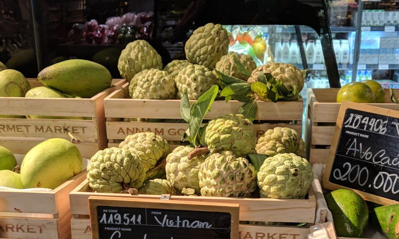 Sugar apple on display at a grocery store.