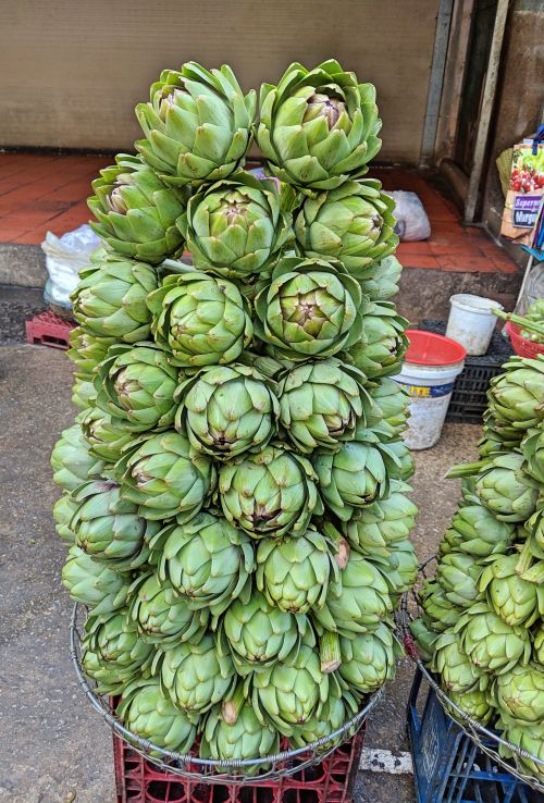 A stack of fresh artichokes for sale at the Dalat Market in Dalat, Vietnam